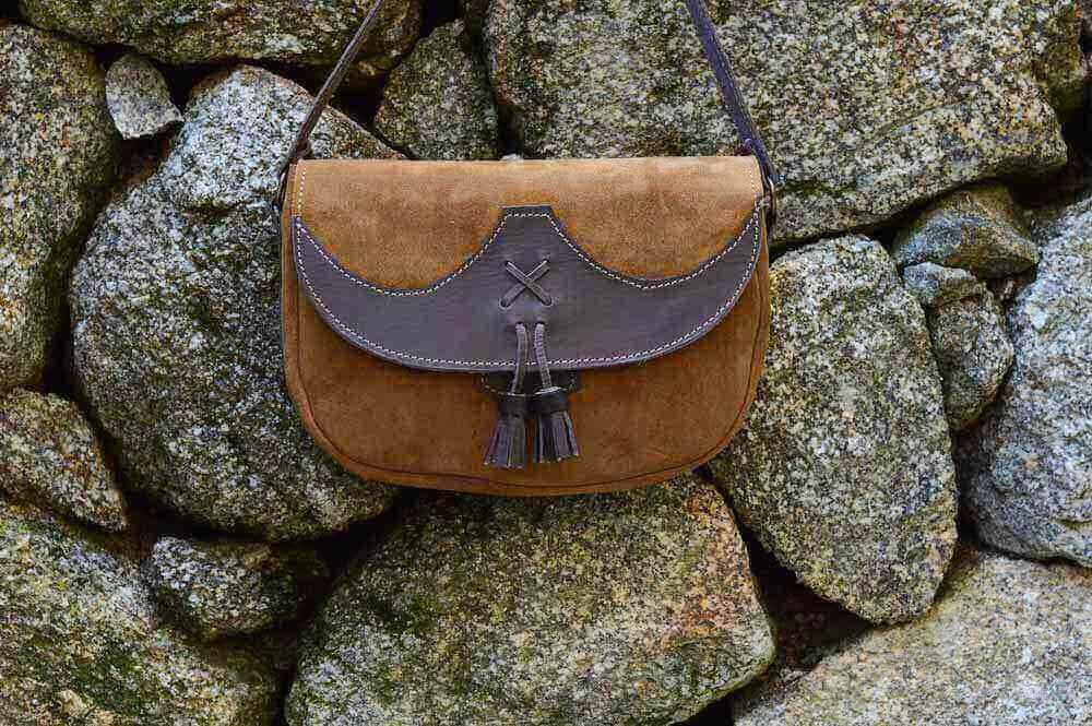 bolsos de mujer, riñoneras, bolsos elegantes, mochilas de moteros